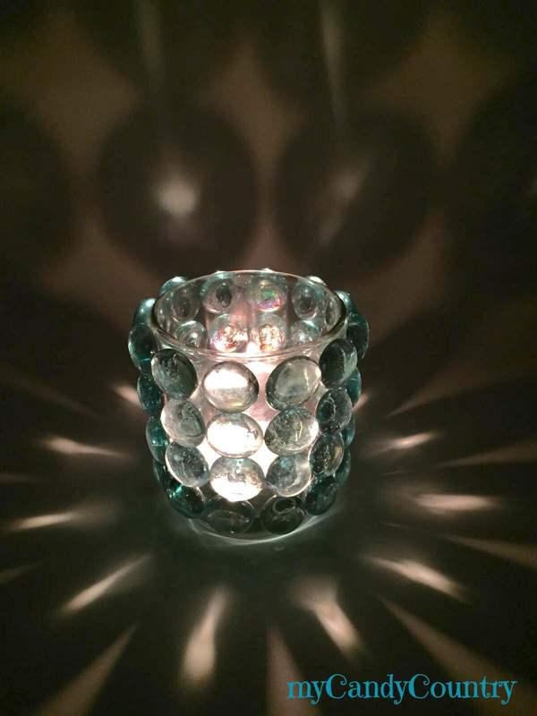 Riciclo creativo portacandele fai da te con pietre - Idee decorative per natale ...